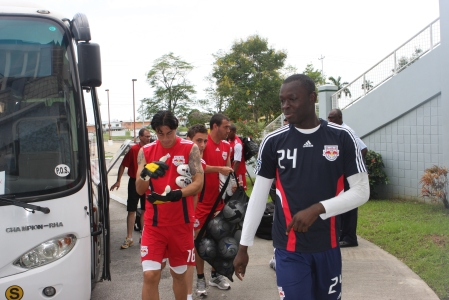 Bouna Coundoul leads the way to training in Trinidad