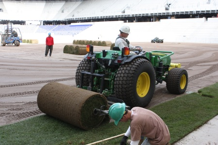 Workers from Landtek install the field at Red Bull Arena